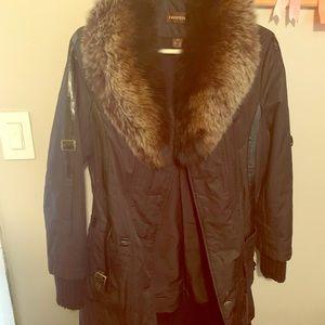 Danier jacket with fox tail trim.
